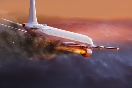 Airplane with engine on fire, concept of aerial disaster. Фото со стока