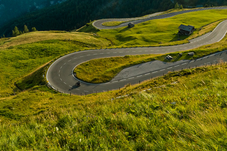 Motorcycle drivers riding in Alpine highway on famous Hochalpenstrasse, Austria, Europe.