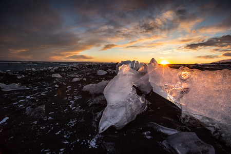Icebergs in Jokulsarlon glacial lake during sunset, Iceland
