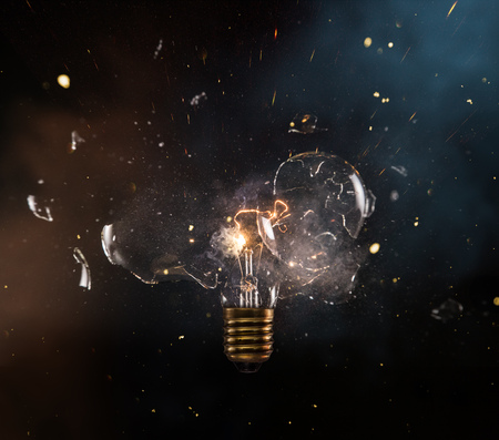 Real explosion of vintage electric bulb. Stock Photo