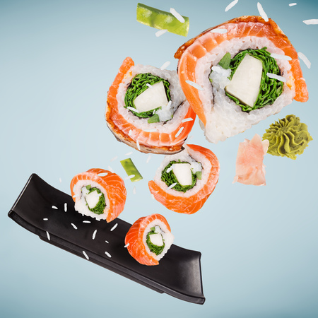Pieces of delicious japanese sushi frozen in the air. Standard-Bild - 108208630