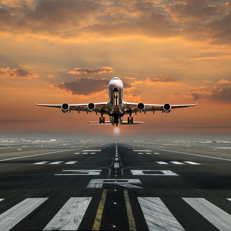 Airplane taking off from the airport, front view.
