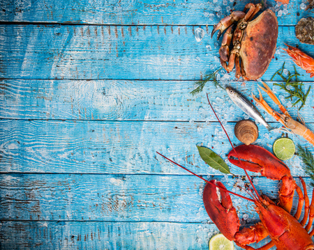 Fresh tasty seafood served on old wooden table. Stock Photo