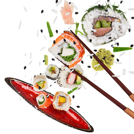 Pieces of delicious japanese sushi frozen in the air. Standard-Bild