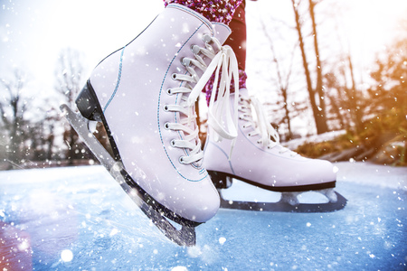 Close-up of woman ice skating on a pond. Banco de Imagens - 108998753