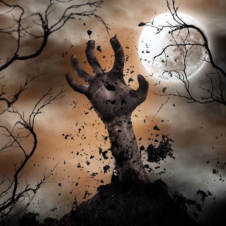 Scary Halloween background with zombie hand. Stock Photo