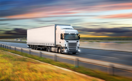 Truck with container on road, cargo transportation concept.