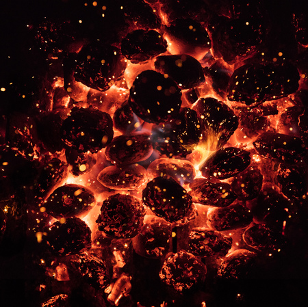 Glowing Hot Charcoal Briquettes on garden grill, close-Up,