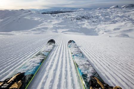 Beautiful winter panorama with fresh powder snow on ski slope. Alpine mountains background.
