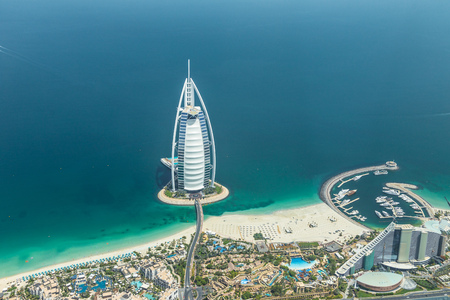 DUBAI, UAE - MAY 28: Burj Al Arab hotel on May 28, 2018 in Dubai, UAE. Burj Al Arab is a luxury unofficial 7star hotel built on an artificial island in front of Jumeirah beach. View from hydroplane. 에디토리얼