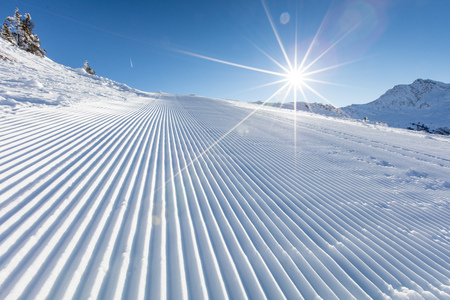 Fresh snow on ski slope during sunny day. Stock Photo