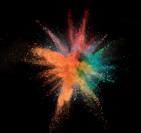 Colored powder explosion on black