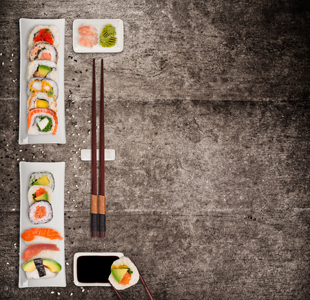 Traditional japanese sushi pieces on rustic concrete Foto de archivo