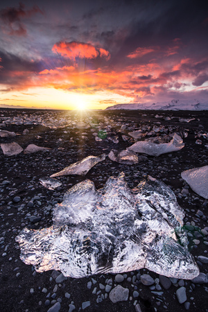 Beautiful sunset over famous Diamond beach, Iceland.