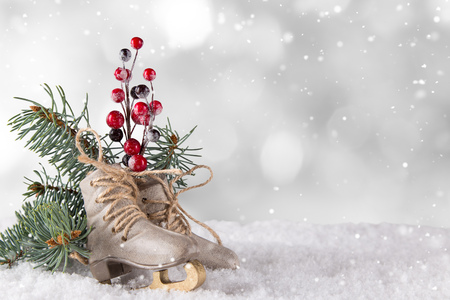 Christmas decoration ice skates on wooden background