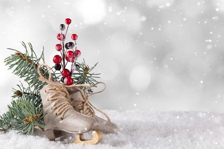 Christmas decoration ice skates on wooden background Stock Photo