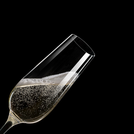 Glass of champagne levitating in the air, celebration theme.