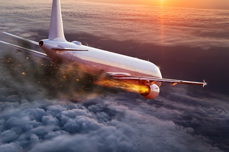 Airplane with engine on fire, concept of aerial disaster. 写真素材