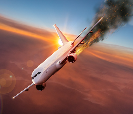 Airplane with engine on fire, concept of aerial disaster. Imagens