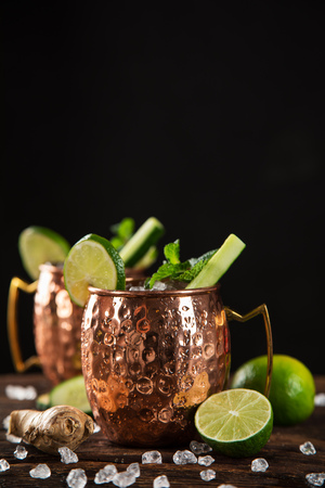 Famous Moscow mule alcoholic cocktail in copper mugs.