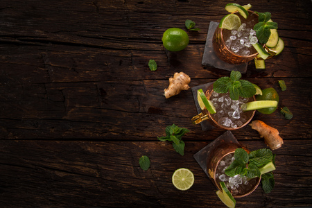 Famous Moscow mule alcoholic cocktail in copper mugs. Stock Photo - 114505719