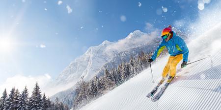Skier skiing downhill in high mountains Reklamní fotografie