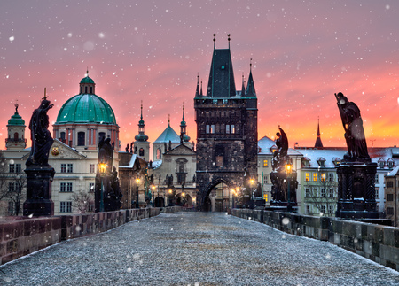 Famous historic Charles bridge in winter morning, Old Town bridge tower, Prague, Czech republic.