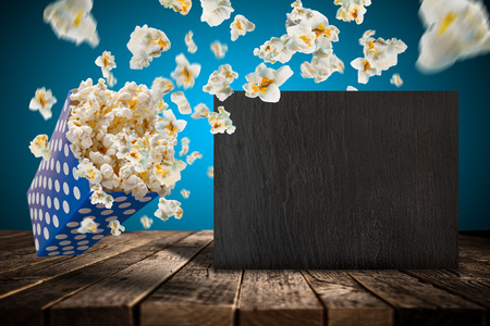 Popcorn explosion on old wooden table.