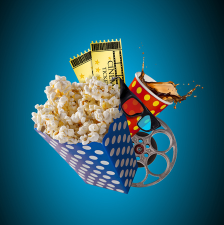 Pop-corn, movie tickets, clapperboard and other things in motion. Cinema concept. Imagens - 115457805