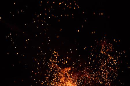Burning sparks flying. Beautiful flames background. Stock Photo