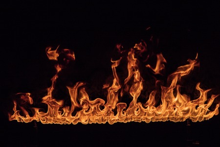 Texture of fire on a black background. 版權商用圖片 - 119166928