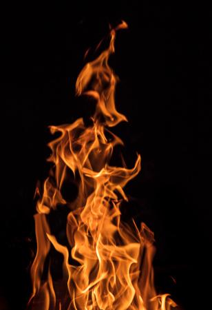 Texture of fire on a black background. 版權商用圖片