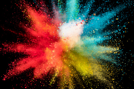 Colored powder explosion on black background. Freeze motion. Stock Photo