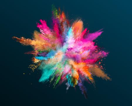 Colored powder explosion on dark gradient