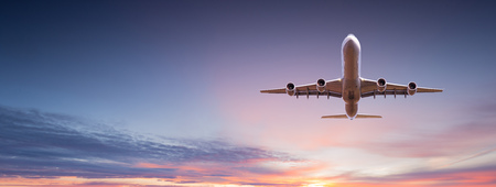 Commercial airplane jetliner flying above dramatic clouds. 스톡 콘텐츠 - 117975876