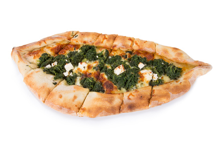Traditional turkish pizza pide with spinach on white. Top view.