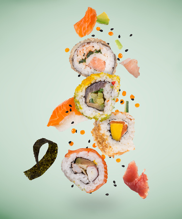 Pieces of delicious japanese sushi frozen in the air. Standard-Bild - 119167733