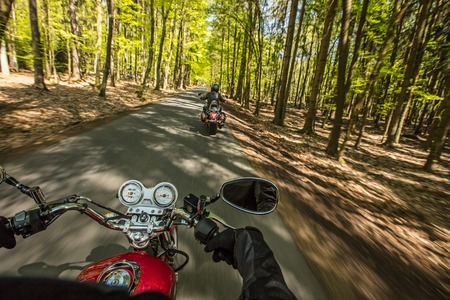 Motorcycle driver riding in spring forest. Stok Fotoğraf - 123560932