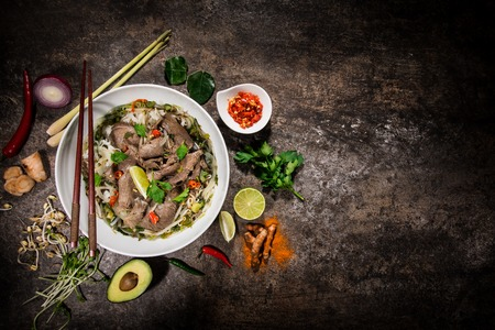 Pho bo asian food  with various ingredients on rustic stone