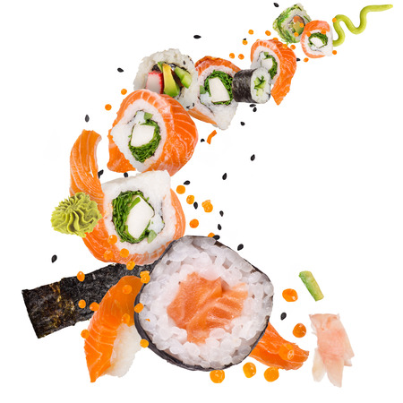 Pieces of delicious japanese sushi frozen in the air. Standard-Bild - 120778471