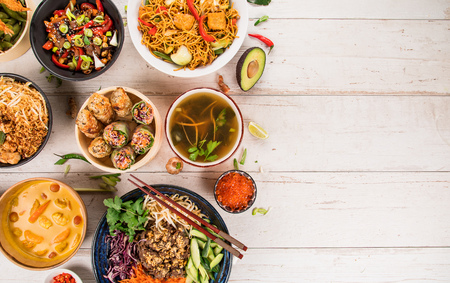 Asian food background with various ingredients on rustic wooden table. Stok Fotoğraf
