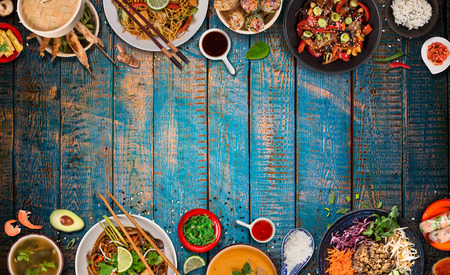 Asian food  with various ingredients on rustic wooden table