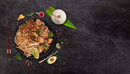 Pad thai asian food  with various ingredients on rustic stone