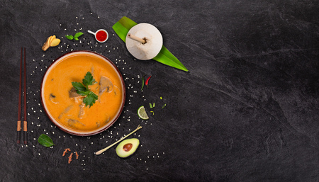 Yellow curry asian food   with various ingredients on stone table.