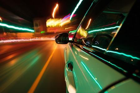 Speeding car driving in a night city. Stock fotó