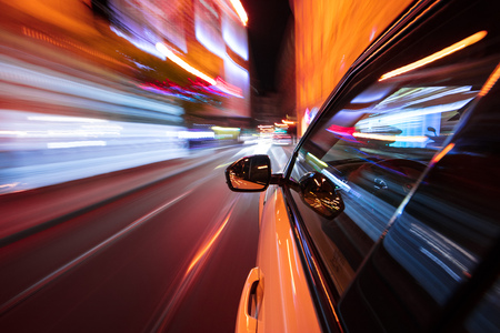 Speeding car driving in a night city. Imagens
