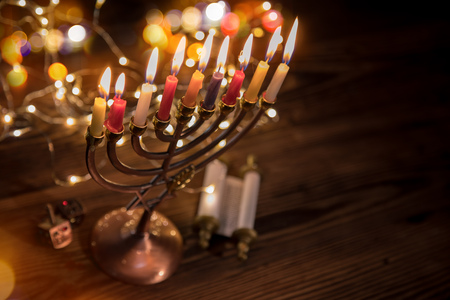 Concept of jewish holiday Hanukkah with menorah (traditional candelabra) Stockfoto