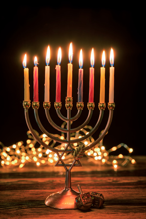 Concept of jewish holiday Hanukkah with menorah (traditional candelabra) Imagens