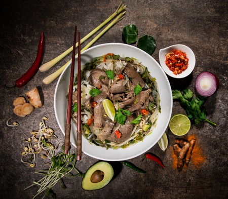 Pho bo asian food background with various ingredients on rustic stone background , top view. Stok Fotoğraf
