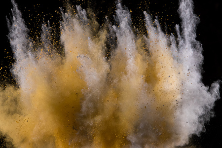 Golden powder explosion on black